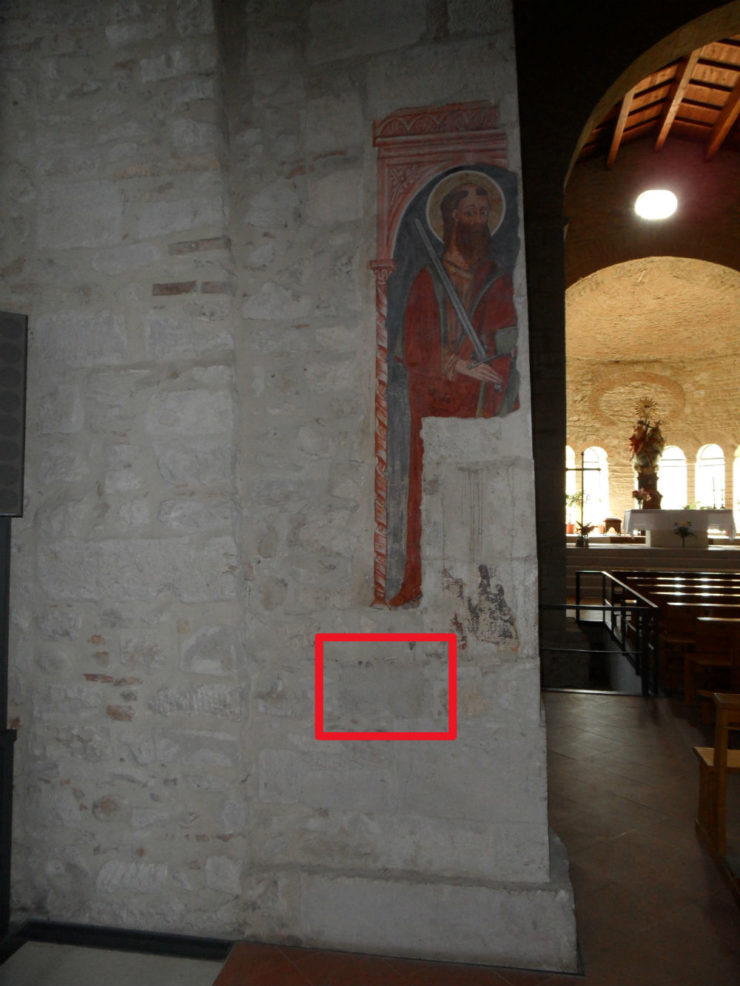 Item 9 embedded in church pillar.